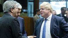 Глава МИД Италии Паоло Джентилони (слева) и министр иностранных дел Великобритании Борис Джонсон. Архивное фото