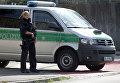 Сотрудник полиции на месте взрыва чемодана в баварском городе Цирндорф. 27 июля 2016