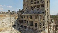 Разрушенное здание в квартале Бани-Зейд на севере Алеппо. Сирия. Архивное фото