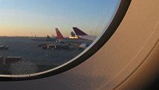 Вид из иллюминатора самолета. Архивное фото