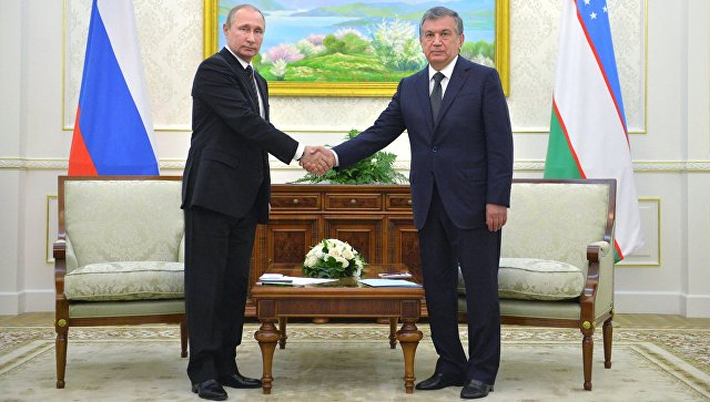 Президент РФ Владимир Путин и премьер-министр Узбекистана Шавкат Мирзиёев во Дворце форумов - самаркандской резиденции президента Узбекистана. 6 сентября 2016