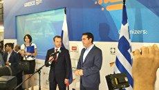 Переговоры премьер-министра Греции Алексиса Ципраса и зампредседателя правительства РФ Аркадия Дворковича