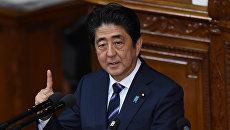 Премьер-министр Японии Синдзо Абэ во время выступления на открытии внеочередной сессии нижней палаты представителей японского парламента. 26 сентября 2016