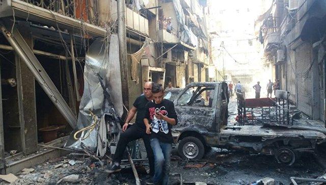 Последствия минометного обстрела христианского квартала Мидан в Алеппо. Архивное фото