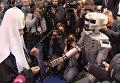 Робот-андроид протянул руку Патриарху Кириллу на выставке православного форума
