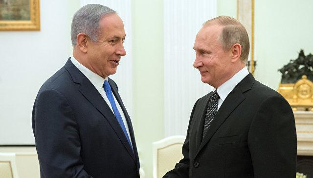 Президент России Владимир Путин (слева) и премьер-министр Израиля Биньямин Нетаньяху. Архивное фото