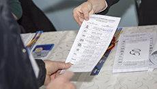 Во время голосования на выборах президента Молдавии. Архивное фото