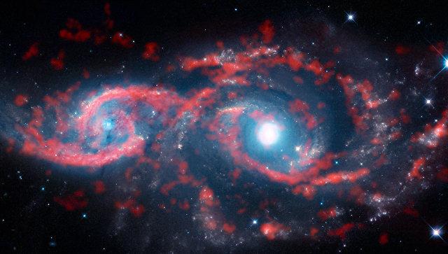 Галактики IC 2163 и NGC 2207, превратившаяся в своеобразную пару глаз в результате космического ДТП