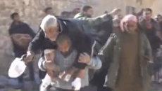 Мирные жители покидали один из районов Алеппо под пулями боевиков