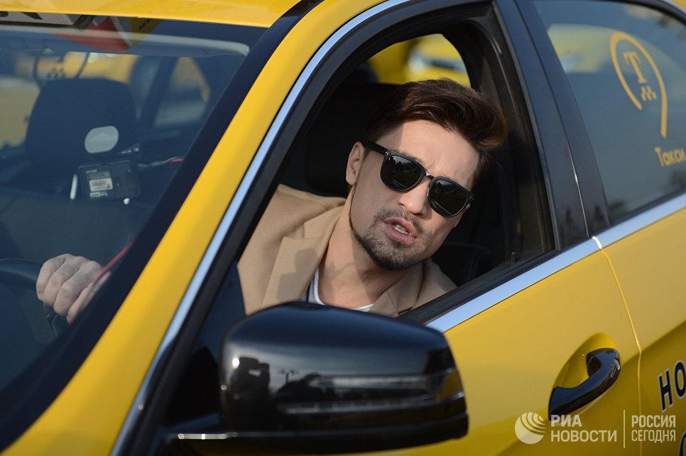 Певец Дима Билан принимает участие в благотворительной акции в рамках праздника День московского такси