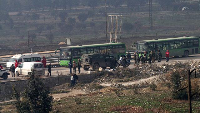 Эвакуация боевиков и мирных жителей из восточного Алеппо. Архивное фото