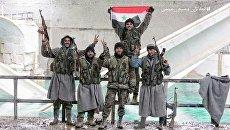 Бойцы сирийской армии на источнике пресной воды Айн-эль-Фиджи под Дамаском. Архивное фото