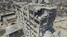 Разрушенные здания в квартале Бани-Зейд на севере Алеппо