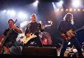 Участники группы Metallica Роберт Трухильо, Джеймс Хэтфилд и Кирк Хэммет на фестивале Voodoo Music Experience в Новом Орлеане