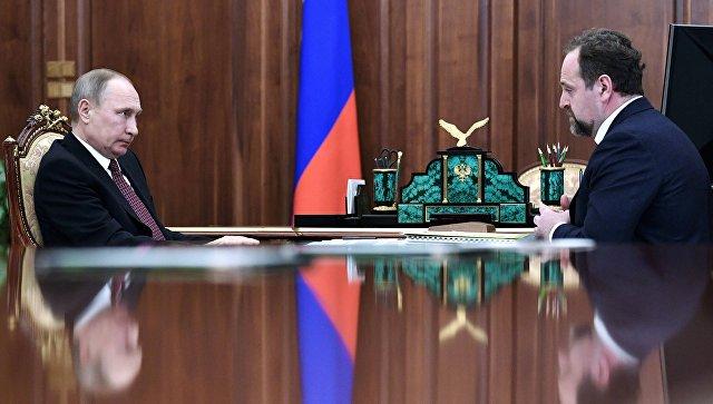 Президент РФ Владимир Путин и министр природных ресурсов и экологии РФ Сергей Донской во время встречи. 20 марта 2016