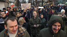 Участники уличной акции Марш нетунеядцев в Минске. 15 марта 2017