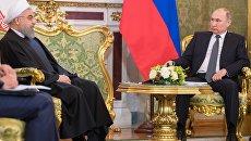 Президент РФ Владимир Путин и президент Исламской Республики Иран Хасан Рухани во время встречи в Москве. 28 марта 2017 года