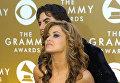 Кармен Электра и гитарист Дэйв Наварро на 46-й ежегодной премии Грэмми
