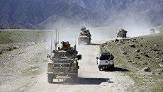 Патруль американских и афганских военных в районе места бомбардировки в районе Ачин в провинции Нангархар. 14 апреля 2017