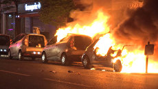 Погромы в Париже после первого тура выборов: горящие машины и перевернутые киоски