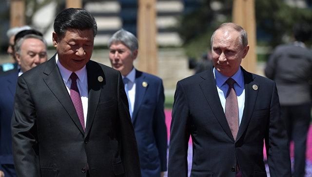 Президент РФ Владимир Путин и председатель Китайской Народной Республики Си Цзиньпин. 15 мая 2017