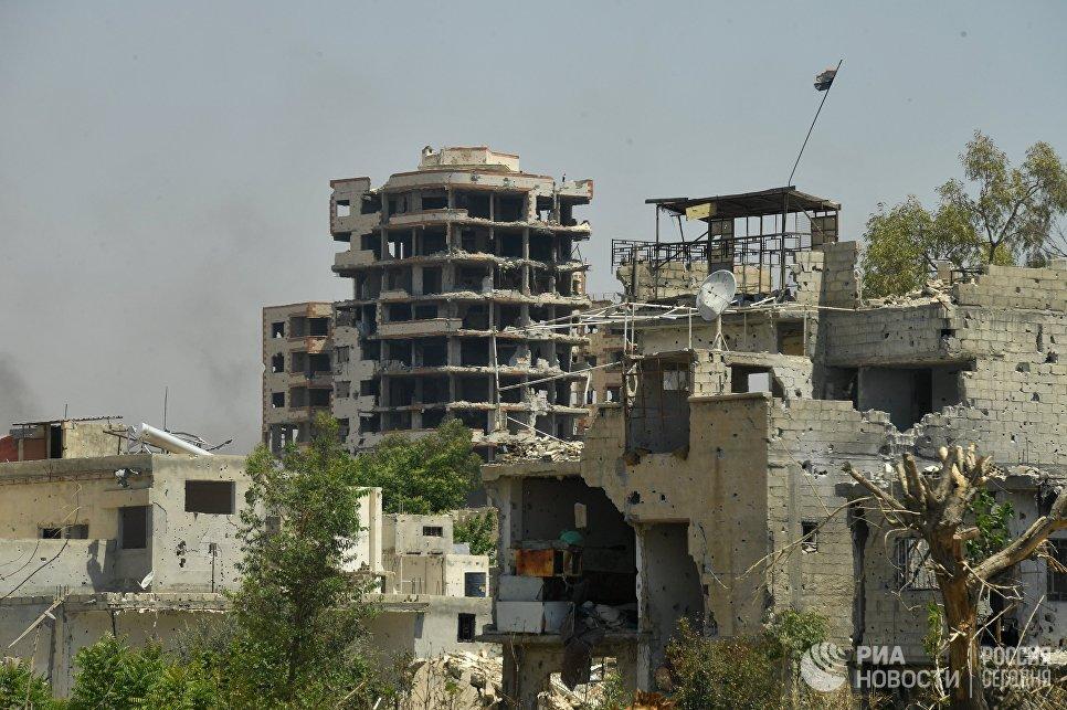 Разрушенные здания в квартале Кабун в пригороде Дамаска