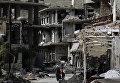 Последствия авиаударов в сирийском городе Забадани. 18 мая 2017