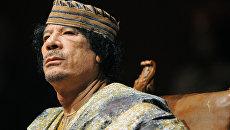 Лидер Социалистической Народной Ливийской Арабской Джамахирии Муамар Каддафи. 6 декабря 2009