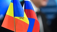 Флаги Молдавии и России на пресс-конференции Игоря Додона. Архивное фото