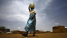 Беженка из Южного Судана в лагере для беженцев. Архивное фото