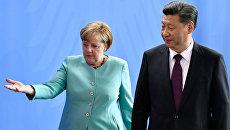 Канцлер Германии Ангела Меркель и председатель КНР Си Цзиньпин во время встречи в Берлине. 5 июля 2017