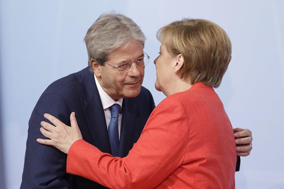 Президент Италии Паоло Джентилони и канцлер ФРГ Ангела Меркель в первый день саммита G-20 в Гамбурге