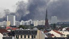 Дым над Гамбургом во время проведения саммита G20. 7 июля 2017