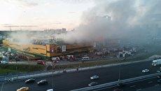 Тушение пожара в здании торгового центра РИО на Дмитровском шоссе в Москве