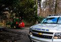 Полицейский автомобиль у поместья Килленворт в районе Глен-Коув штат Нью-Йорк