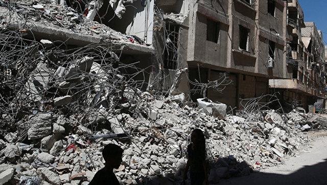 Руины в восточном пригороде Дамаска Гуте. 19 июля 2017