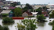 Здания, затопленные в результате наводнения, в Уссурийске. Архивное фото