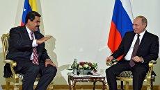 Президент РФ Владимир Путин и президент Венесуэлы Николас Мадуро. Архивное фото