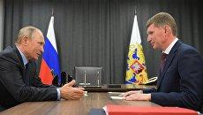 Владимир Путин во время рабочей встречи с временно исполняющим обязанности губернатора Пермского края Максимом Решетниковым. 8 сентября 2017