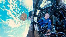 Российский космонавт, герой России Андрей Борисенко. Кадр из первого в истории панорамного видео Земли, снятое на борту МКС