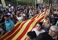 Участники забастовки в поддержку референдума о независимости Каталонии в Барселоне