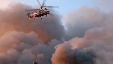 Тушение пожара на строительном рынке Синдика, расположенном у МКАД в районе Строгино. 8 октября 2017