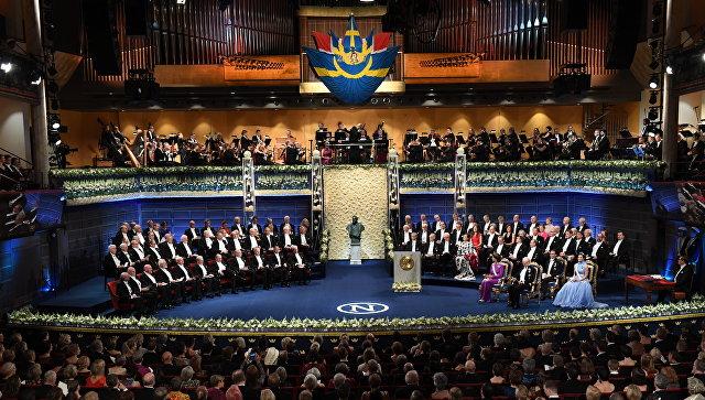 Члены Шведской королевской семьи и лауреаты Нобелевской премии на церемонии открытия Нобелевской премии в Концертном зале в Стокгольме, Швеция. Архивное фото