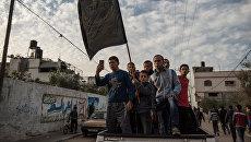 Похороны местного жителя в секторе Газа, погибшего в результате обстрела. 12 декабря 2017