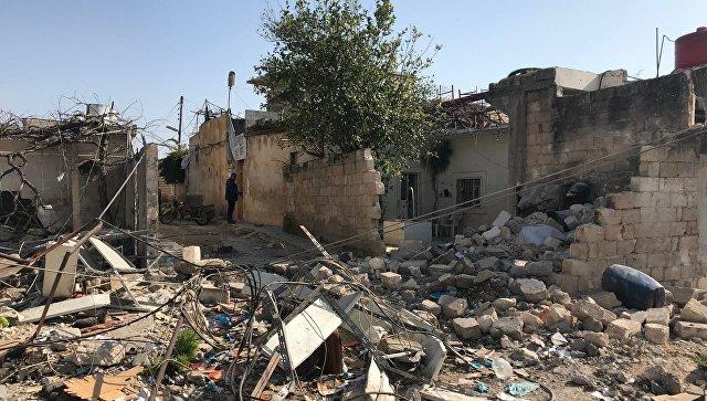 Последствия обстрела турецкими военными поселения Дженджерес в кантоне Африн на севере Сирии