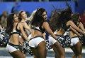 Девушки из группы поддержки во время выступления на стадионе U.S. Bank Stadium в Миннеаполисе, США