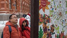 Туристы из Китая изучают программу празднования Масленицы