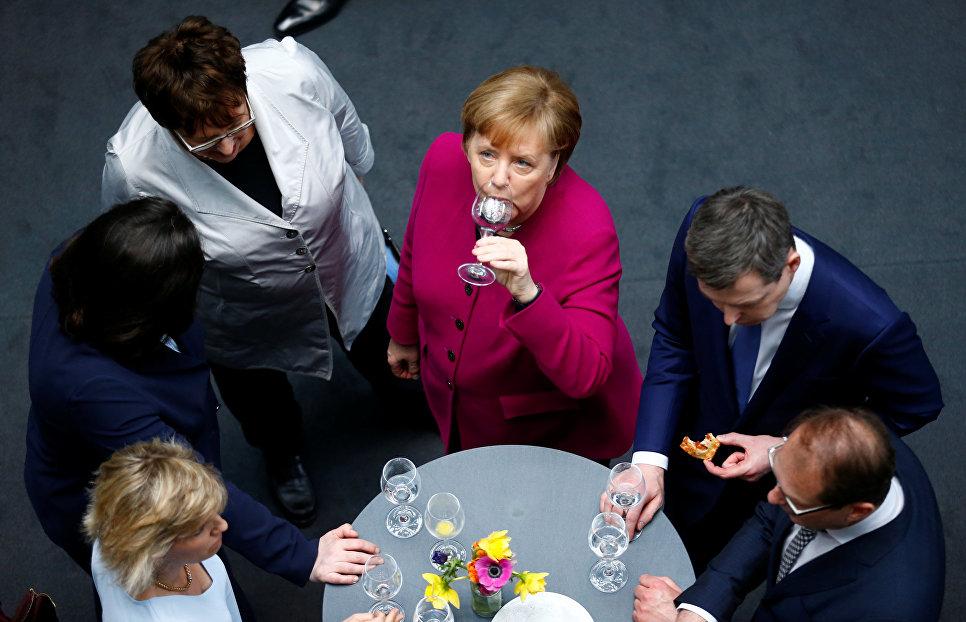 Канцлер Германии и лидер ХДС Ангела Меркель после подписания коалиционного соглашения в Берлине, Германия. 12 марта 2018 года