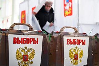 Урны на выборах президента РФ на избирательном участке №13-06 в Москве. 18 марта 2018
