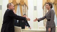 Президент РФ Владимир Путин и кандидат в президенты РФ от партии Гражданская инициатива Ксения Собчак. 19 марта 2018